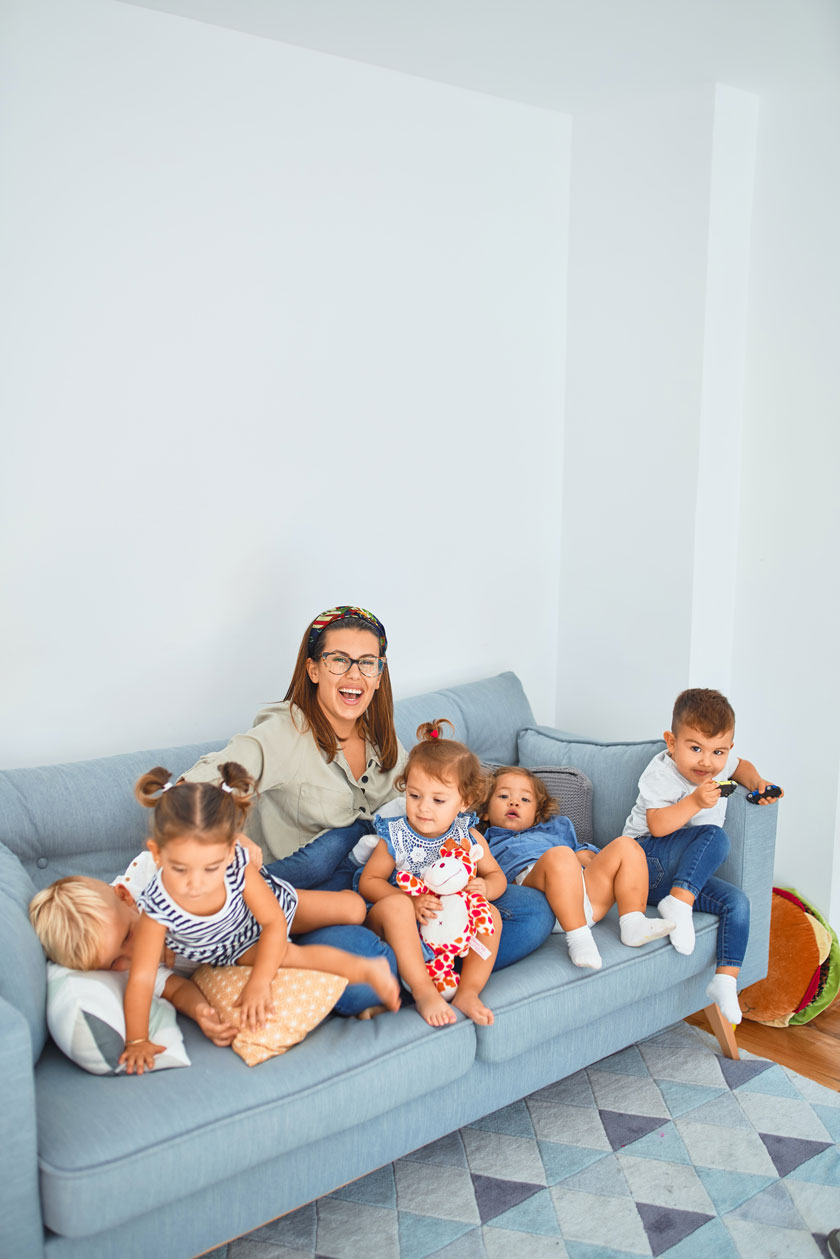 Generic image of childminder with a group of children